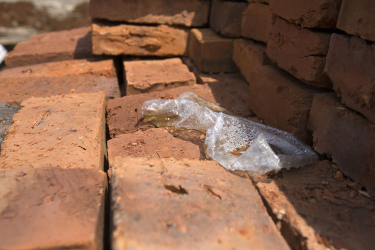 Brick No People Close-up Day Solid Outdoors Nature High Angle View Selective Focus Still Life Sunlight Rock Plastic Garbage