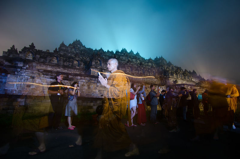 15 may 2014, Magelang, Indonesia : Participants releasing lanterns over the Borobudur temple in Magelang, Central Java during Vesak/Waisak Day celebrations Adult Architecture Belief Built Structure Crowd Group Of People Large Group Of People Men Nature Place Of Worship Real People Religion Sky Spirituality Standing Women