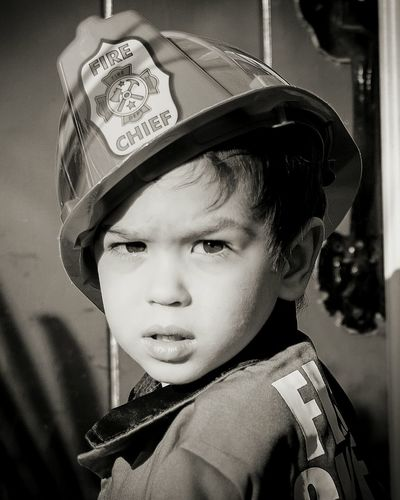 Portrait of boy in firefighter costume