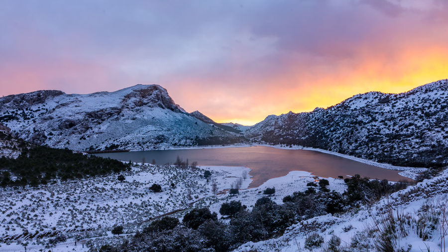 Winter in Mallorca Reflection EyeEm Best Shots Beauty In Nature Cloud - Sky Cold Temperature Environment Idyllic Lake Landscape Mountain Mountain Peak Mountain Range No People Non-urban Scene Scenics - Nature Sky Sky Colors Snow Snowcapped Mountain Sunset Tranquil Scene Tranquility Water Winter