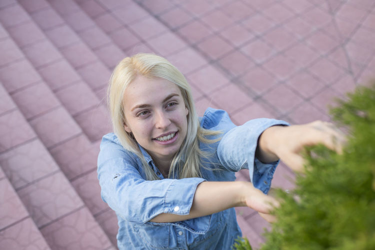 High angle view of woman reaching plants