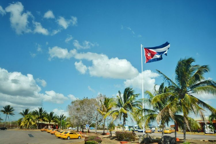 The feeling when you know your almost there. Flag Patriotism Taxi Cuban Flag Cuba Varadero Holiday Vacations Trip Road Trip By The Sea Travel Travel Destinations Traveling
