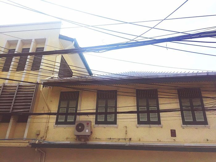 Old vintage building Architecture Building Exterior Built Structure Cable Day Window Low Angle View Outdoors No People Electricity  Sky Telephone Line
