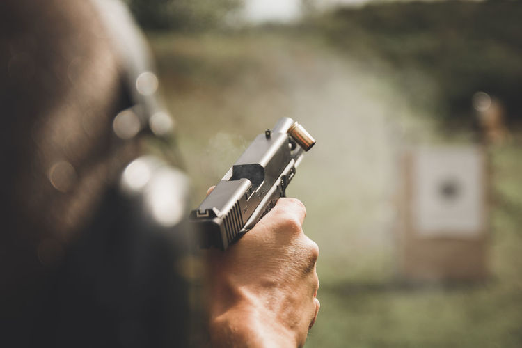 Close-Up Of Person Holding Gun