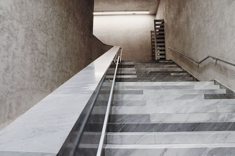A staircase in Kunstmuseum Basel. A very cold atmosphere strongly contrasts to the art that is displayed inside the exhibition rooms. Staircase Staircases Staircase Perspective Stairs_collection Museum Basel Basel, Switzerland Kunstmuseumbasel Cold Atmosphere Architecture_collection Architecture Details Marble The Graphic City The Architect - 2018 EyeEm Awards