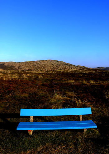 Beauty In Nature Blue Blue Park Bench Buenosaires Clear Sky Coast Grass Landscape Nature North Sea Outdoors Sea Tranquil Scene Tranquility