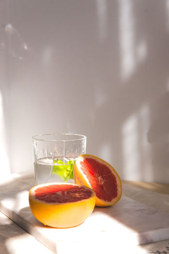 Citrus Fruit Close-up Cross Section Drink Drinking Glass Food Food And Drink Freshness Fruit Glass Healthy Eating Household Equipment Indoors  No People Orange Refreshment SLICE Still Life Table Transparent Wellbeing