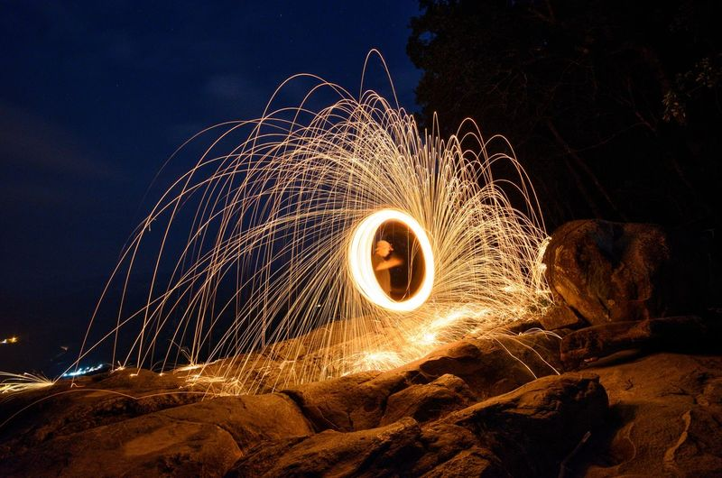 Paint Lighting : circle painted by fire in night (light painting). EyeEm Wallpaper Background Malaysia Fine Art Photography Wire Wool Illuminated Motion Long Exposure Sky Light Painting Entertainment Glowing Firework Exploding Firework Display Firework - Man Made Object Fire - Natural Phenomenon