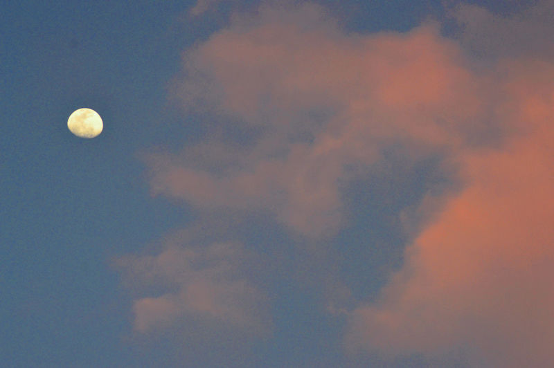 Low angle view of moon against sky at sunset