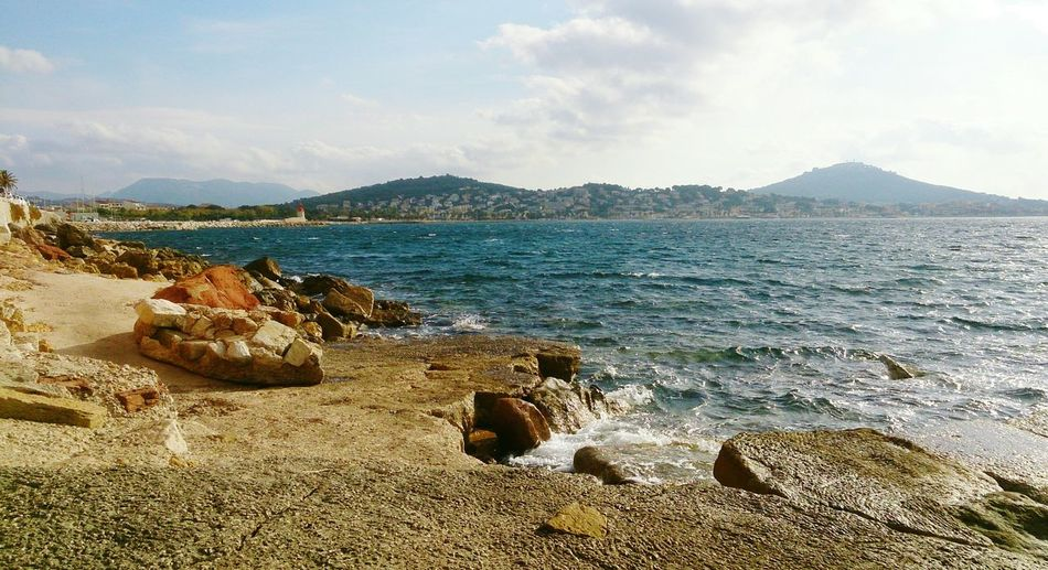 Another view of our secret hideout at the edge of the Sea. Landscape Sanary Sur Mer Sunlight Reflection Seascape Rocks And Water Mountain Range View Water Beach Sea Sand Mountain Sky Shore Rock Formation Horizon Over Water Rushing Ocean Wave Coast