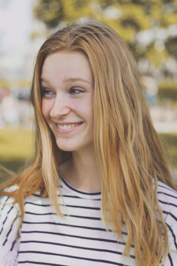 Long Hair Only Women One Woman Only One Young Woman Only Smiling Front View Striped One Person Blond Hair Headshot Casual Clothing Adults Only Portrait Happiness Young Adult Adult Outdoors Day Beautiful Woman People The Portraitist - 2017 EyeEm Awards Moments Of Happiness