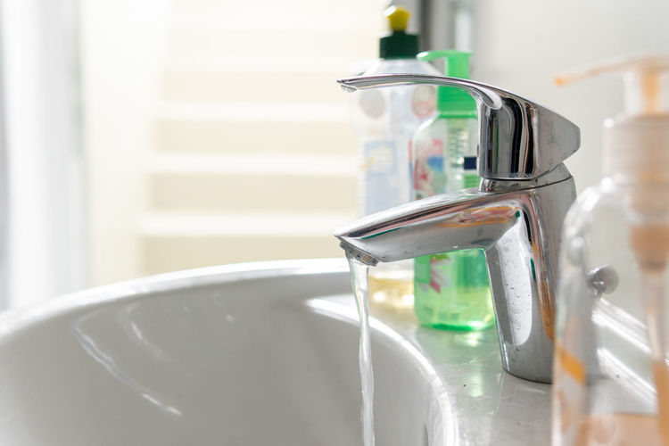Close-up of faucet in kitchen at home