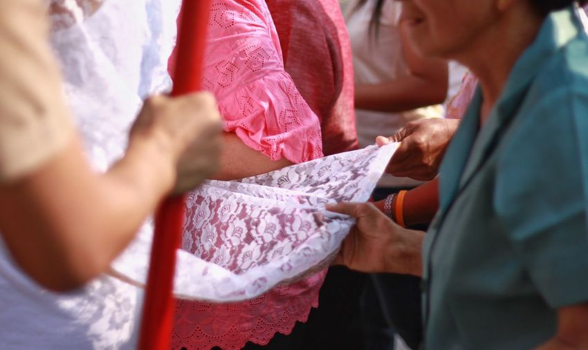 ordination ceremony Thailand Ordination Ordination Ceremony Women Adult Indoors  Holding People Midsection Men Females Selective Focus Giving Receiving Hand Human Hand Incidental People Community Outreach Close-up Service Clothing Care
