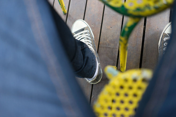 Sit Down Bird Eyes View Canvas Shoe Day Footpath Footwear High Angle View Lifestyles Low Section Part Of Person Personal Perspective Resting Selective Focus Shoe Wood Ground Yellow Chairs A Bird's Eye View With DJI Lieblingsteil EyeEmNewHere Flying High TCPM Live For The Story Out Of The Box Paint The Town Yellow Be. Ready.