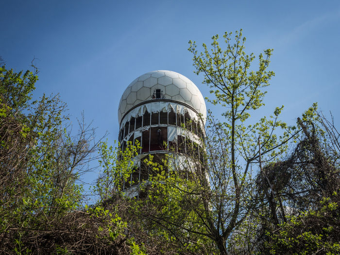 Berlin Abandoned Architecture Blue Branch Building Building Exterior Built Structure Clear Sky Day Dome Growth History Low Angle View Nature No People Outdoors Plant Ruin Ruined Sky Sunlight Teufelsberg Travel Tree