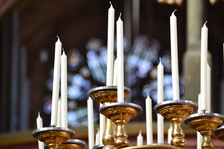 Low angle view of candles on holder at church
