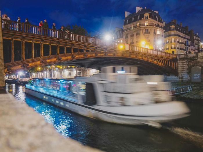 Mobility In Mega Cities Nightphotography Street Light Street Illuminated Night Bridge - Man Made Structure Eyeem Collection Paris, France  City Long Exposure Water Seine Boat HUAWEI Photo Award: After Dark