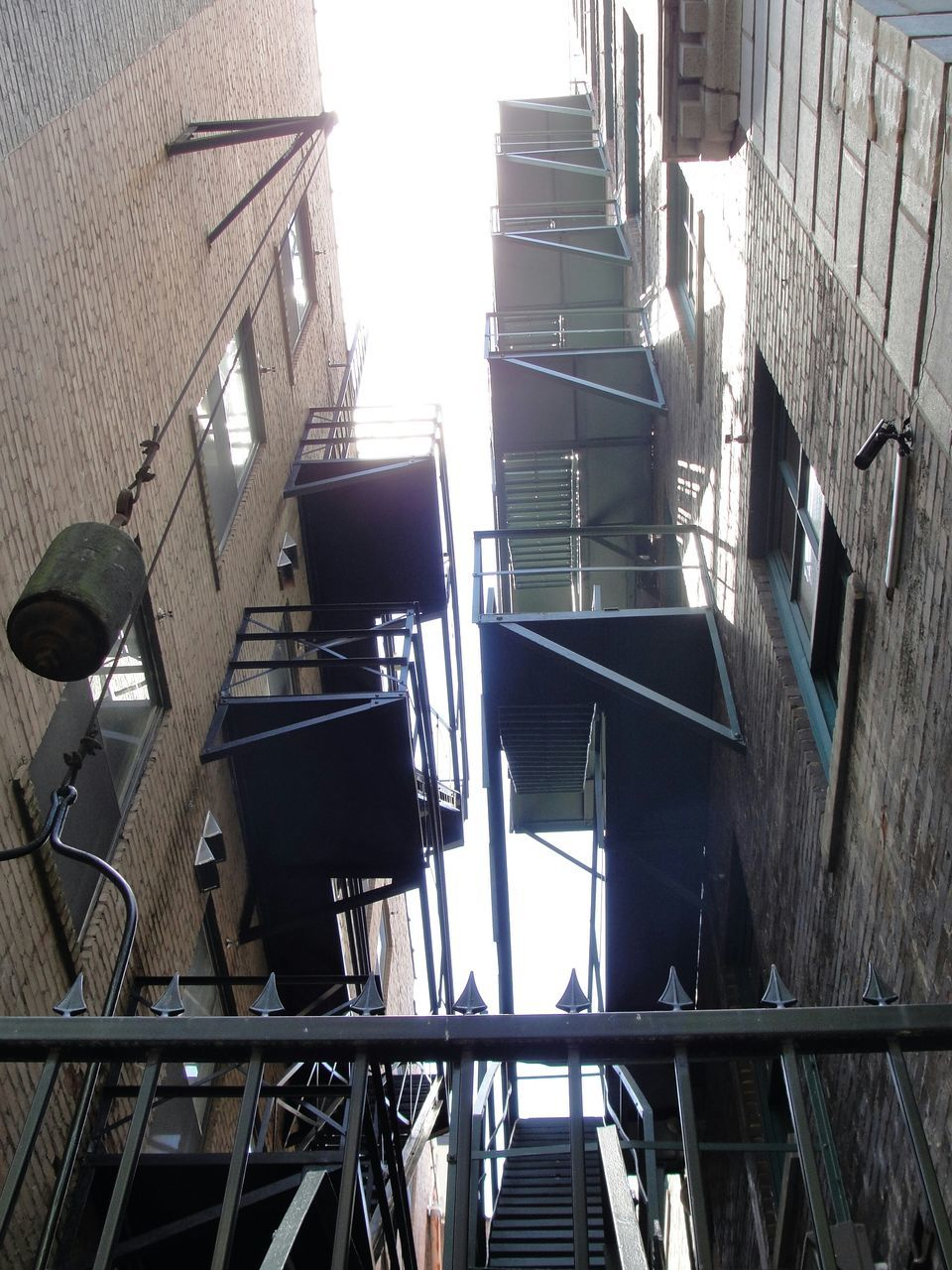 Low Angle View Of Fire Escape In Buildings Against Sky