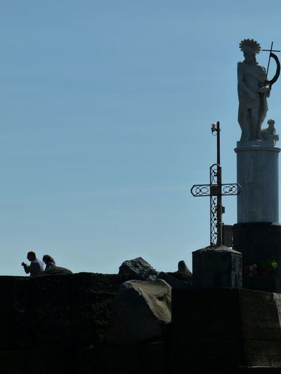 Acitrezza  Acicastello Catania Sicily Harbor Religion Statue Sculpture Low Angle View Love ♥ Silouette No People Outdoors Day Sky Clear Sky Rock Formation Scenic Travel Destinations Waterfront History The Week On EyeEm EyeEmNewHere From My Point Of View EyeEm Best Shots