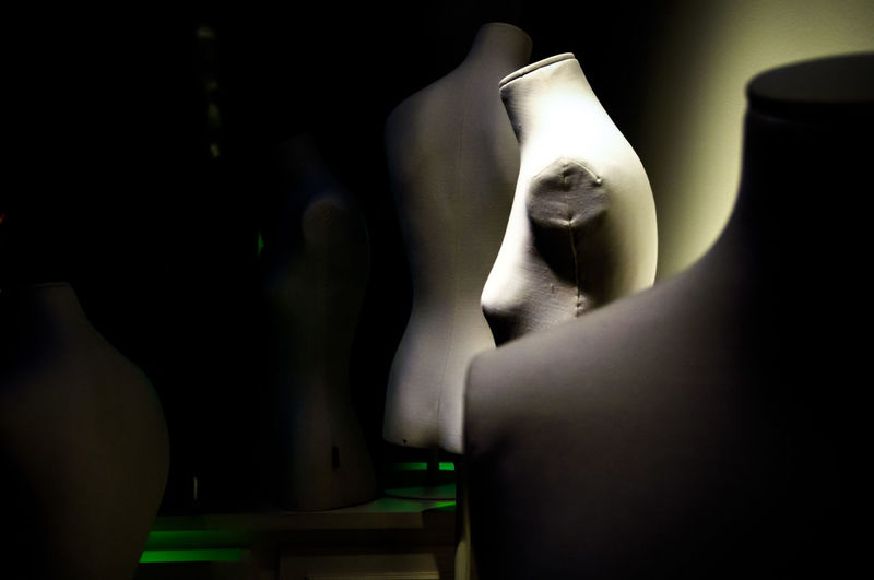 Close-up of mannequin in black background