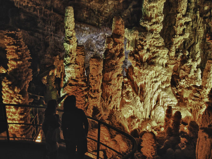 Staring at the underground marvels of Creation Ancient Awe Inspiring Day Eroded Geology Geometry Grotto Natural Pattern Old Ruin Physical Geography Rock Rock - Object Rock Formation Rough Ruined Stalactites Stalagmites Stone