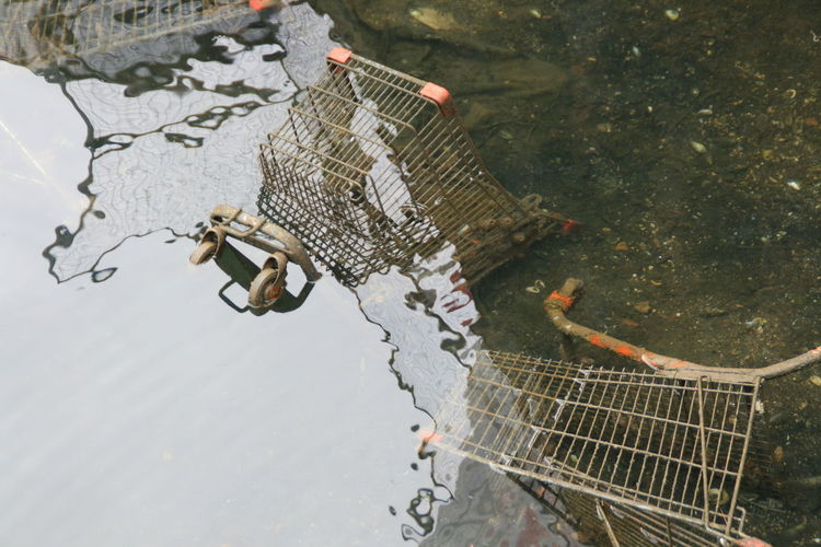 High Angle View Of Abandoned Shopping Carts In Water