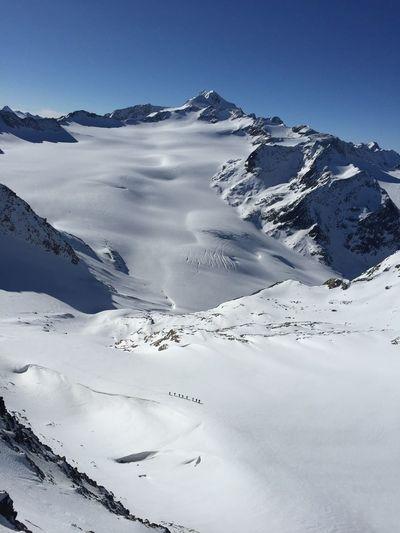 Climbers crossing an alpine glacier
