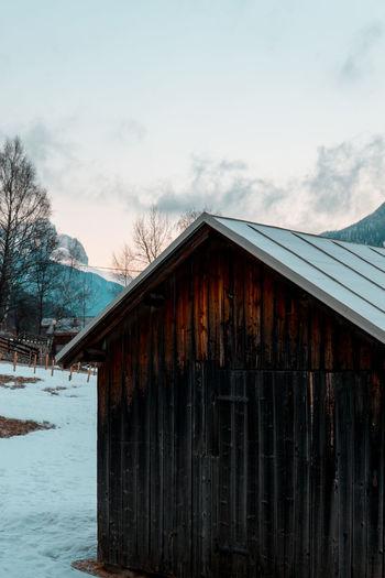 View of frozen building against sky