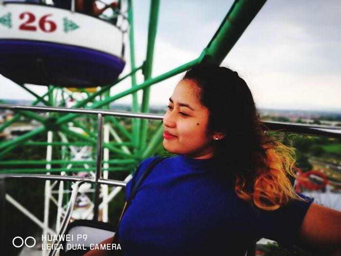 Portrait of boy looking at amusement park