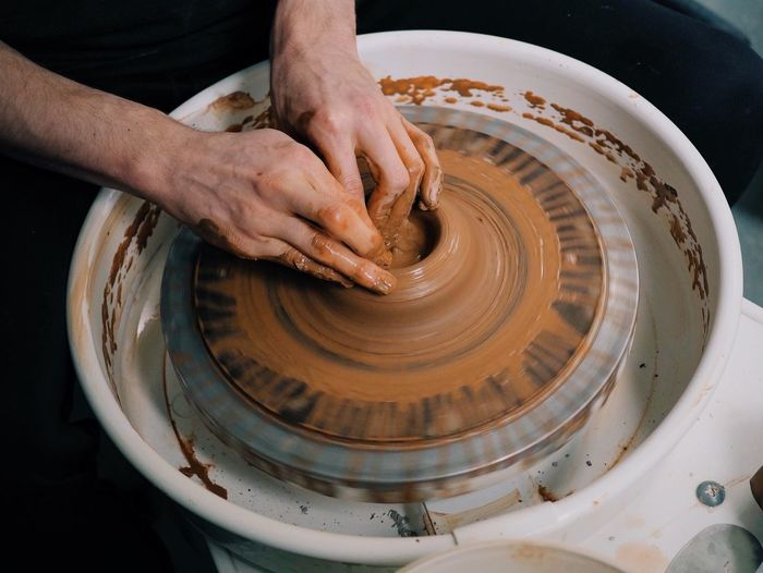 Hands Of Man Working In Pottery Workshop