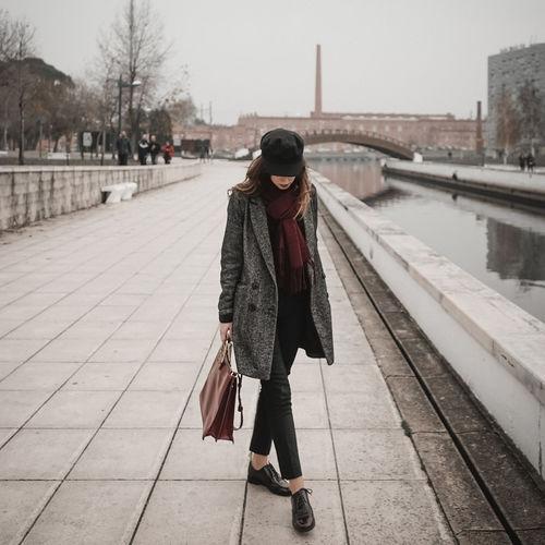 Woman standing on railroad platform
