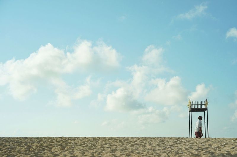 View of tower on beach against sky