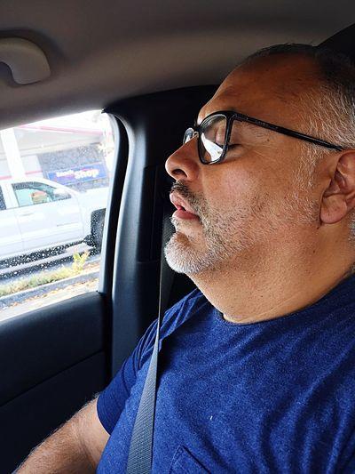 Side View Of Man Sleeping In Car