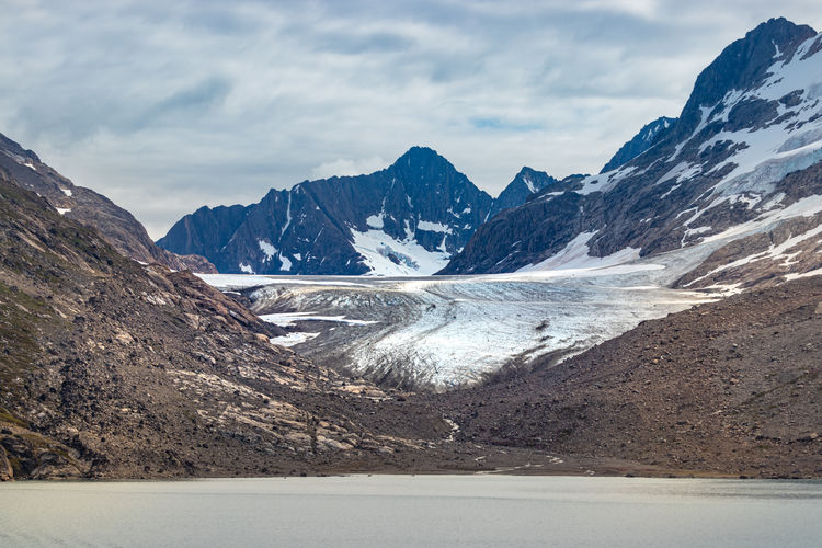 Glacier at the skjoldungen fjord, a coastal island in greenland.
