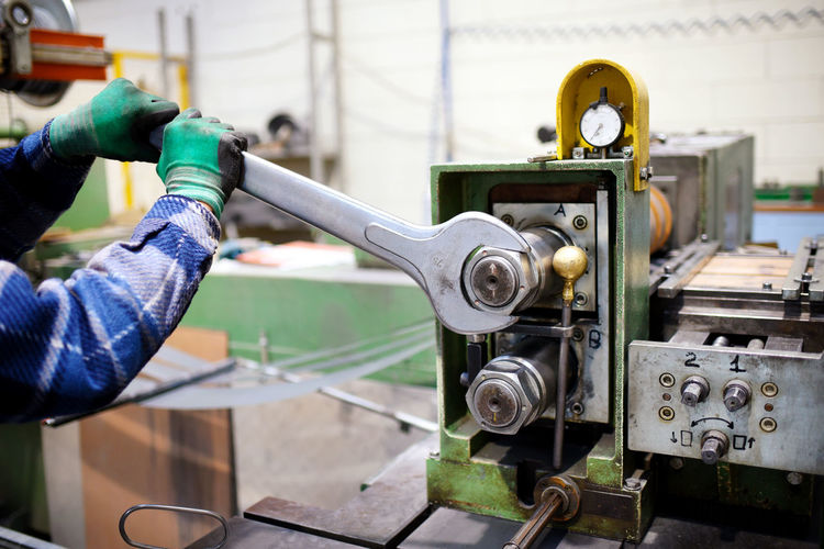 Cropped image of manual worker working in factory