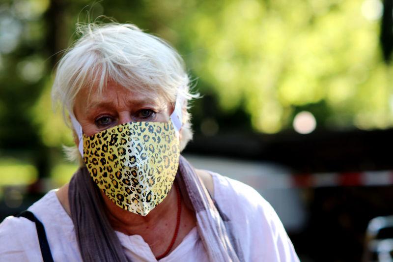 Portrait of woman wearing mask outdoors
