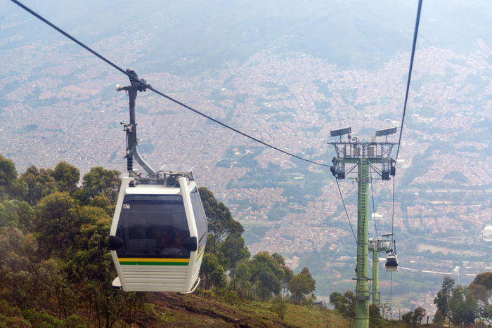 View of cable car high above Medellin, Colombia Above Antioquia Cable Cable Car City Colombia Colombian  Famous Hill Landmark Latin Masstransit Medellín Metro MetroCable Outdoors People South America Street Tourism Town Transportation Travel Urban View