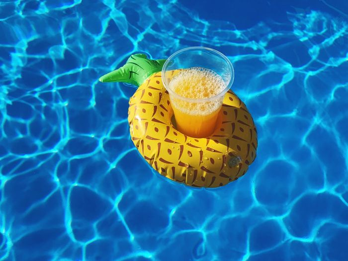 High angle view of lemon slice in swimming pool