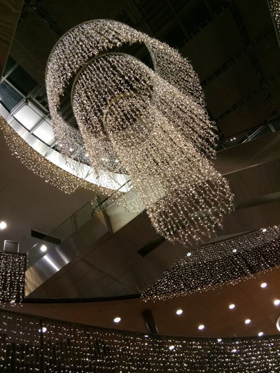 Low Angle View Illuminated Indoors  Decoration Architecture No People Ceiling Lighting Equipment Christmas Lights Night Christmas Built Structure Celebration Hanging Christmas Decoration Chandelier Holiday Light Motion Luxury