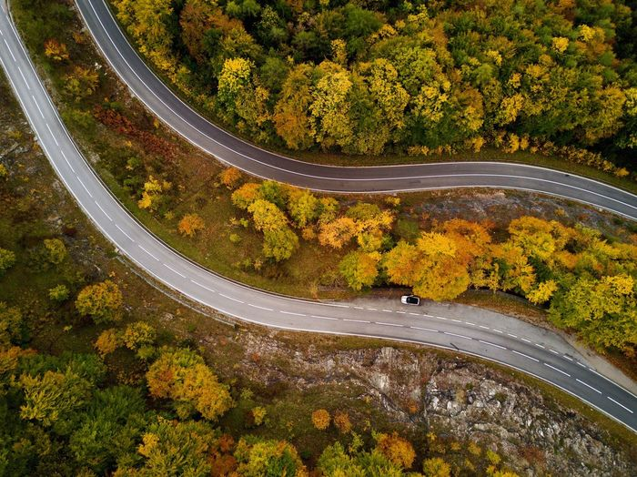 Autumn is in the air! Tree Autumn Road High Angle View Aerial View Scenics Winding Road Nature Multi Colored Transportation Car Change Outdoors Leaf Day Asphalt Curve Beauty In Nature Tranquility Forest Lost In The Landscape Roadtrip EyeEm Nature Lover