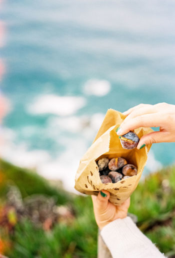 35mm Film Alone Analogue Photography Balance Beginnings Bokeh Close-up Depth Of Field Female Film Photography Filmisnotdead Food Food And Drink Freshness Hand Holding Nature New Life No People Part Of Ready-to-eat Selective Focus Showcase: February Snack Still Life
