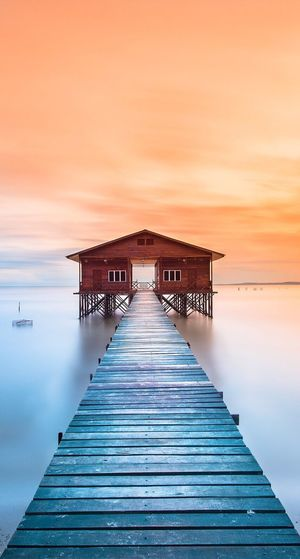 Built Structure Architecture Pier Sunset Water Building Exterior Scenics Sky Sea The Way Forward Tranquil Scene Tranquility Orange Color Beauty In Nature Nature Cloud Majestic Narrow Jetty