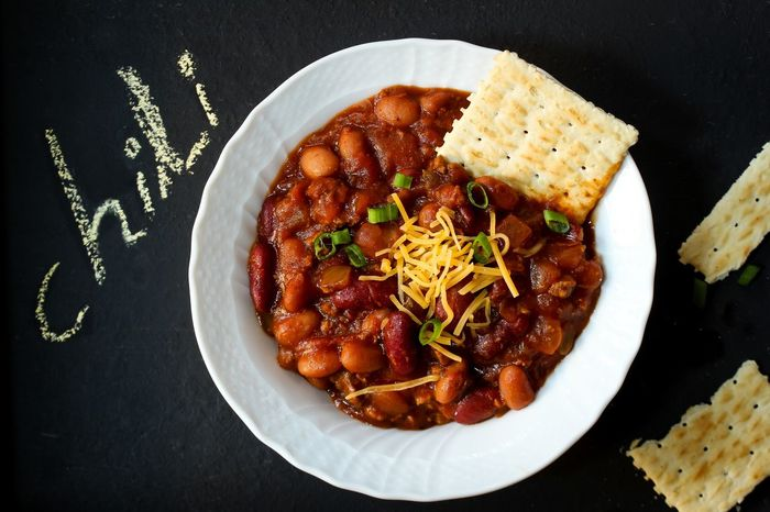 Vegetarian Chili Bowl with beans top down view Beans Check This Out Chili  Close-up Cracker Day Directly Above Food Food And Drink Freshness Healthy Eating High Angle View Indoors  Italian Food Kidney Beans Mexican Food No People Overhead View Plate Ready-to-eat Slow Cooking Spiced Vegetarian Food