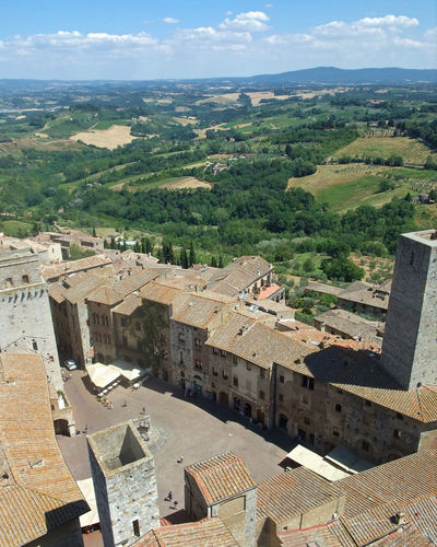 View from tower, San Gimignano, Tuscany Sangimignano San Gimignano Tuscany Italy Ancient Typical Village Unesco Florenz Stone Rocks History Historical Monument Aerial View No People Tree Mountain Day Architecture Outdoors Sky Building Exterior Nature Neighborhood Map