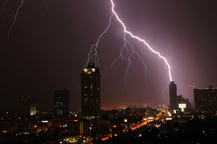 Lightning storm in Bangkok, Thiland Bangkok Thailand. City Cityscape Cityscape Illuminated Light And Shadow Lightning Storm Lightning Strikes Nature Night Outdoors Sky Spotted In Thailand T Thunderstorm