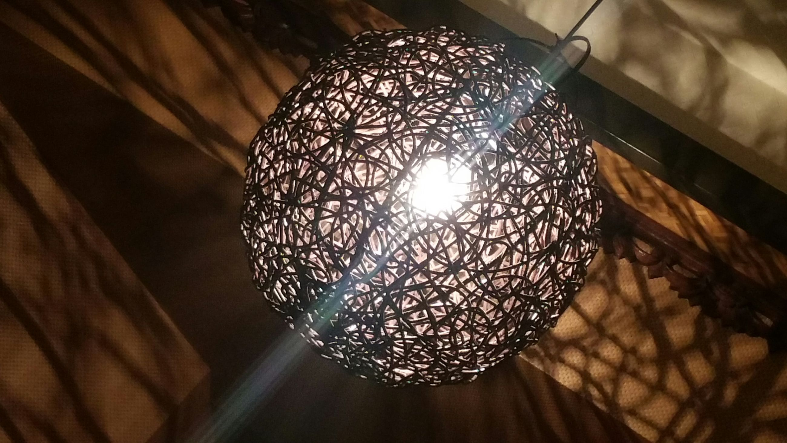 indoors, pattern, decoration, ceiling, design, hanging, low angle view, lighting equipment, illuminated, close-up, decor, shape, shiny, chandelier, glowing, crystal, no people, directly below, electricity, backgrounds