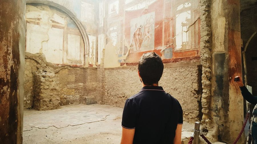 Napoli Pompeii  Stories From The City Travel Abandoned Ancient Civilization Architecture Building Exterior Built Structure Day History Indoors  Leisure Activity Lifestyles Men Napoliphotoproject Old Ruin One Person People Photo Photography Place Of Worship Real People Rear View Standing EyeEmNewHere