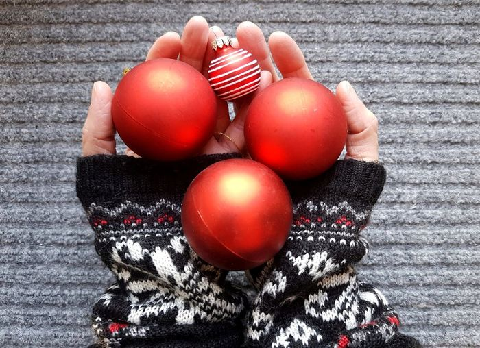 Cropped hands holding baubles during christmas