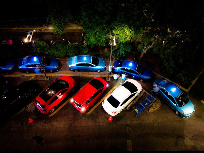 High angle view of car on illuminated street at night