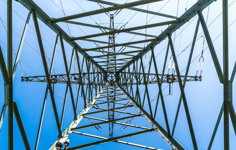 Power Industry Business Energy Sky Connection Electricity Pylon Electricity  Built Structure Cable Power Supply Architecture Low Angle View Technology Metal Fuel And Power Generation Blue Clear Sky Directly Below Pattern Power Line